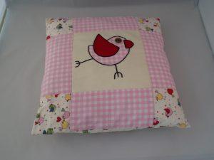 applique bird with patchwork border